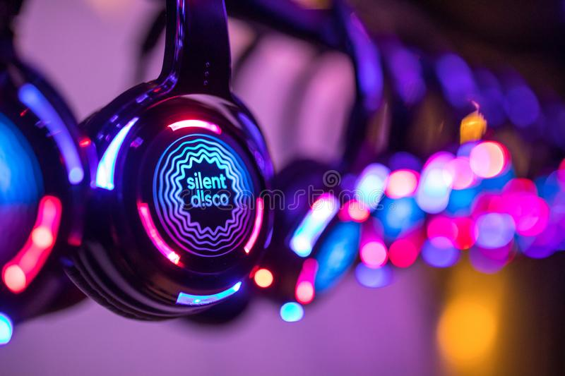 Colorful Silent Disco Headphones at an event stock images