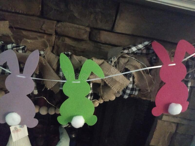 Colorful Silhouette rabbit cutouts on a string royalty free stock image