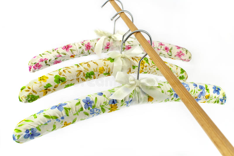 Colorful silk clothes hangers stock images