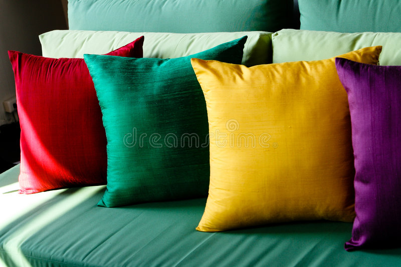 Colorful silk cushions royalty free stock photography