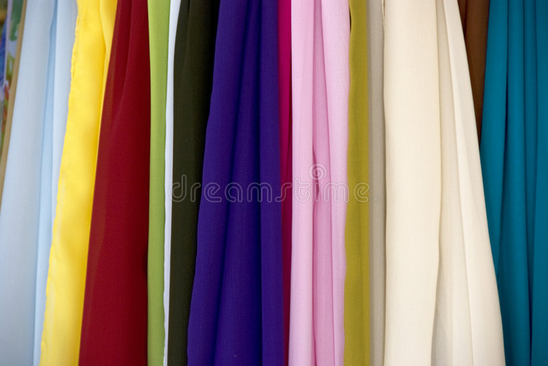 Colorful silk scarfs. On a market in Bellagio - Como Lake - Italy royalty free stock photo
