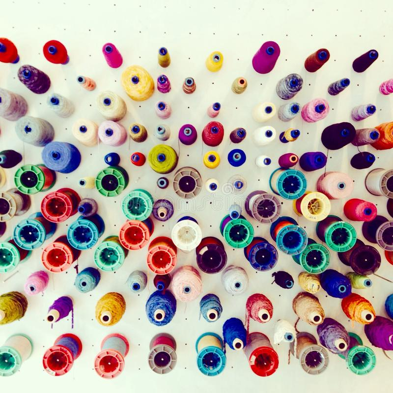 Colorful silk threads display for weaving stock images