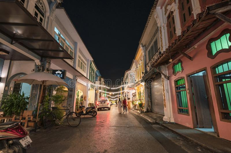 Colorful sino alley townhome with store and lighting decoration at night market, Soi Rommanee stock images