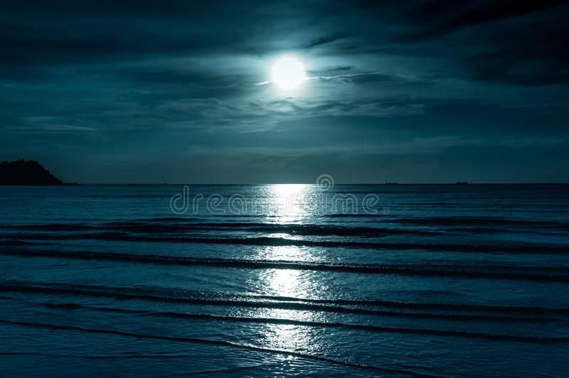 Colorful sky with cloud and bright full moon over seascape. Colorful sky with cloud and bright full moon over seascape in the evening. Serenity nature stock photography