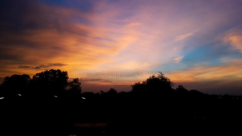 Colorful sky with clouds village royalty free stock photography