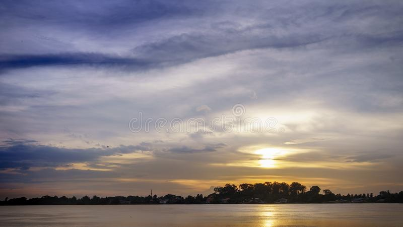 Mirror sunset reflection on the water at Maekhong national river,Thailand royalty free stock photo