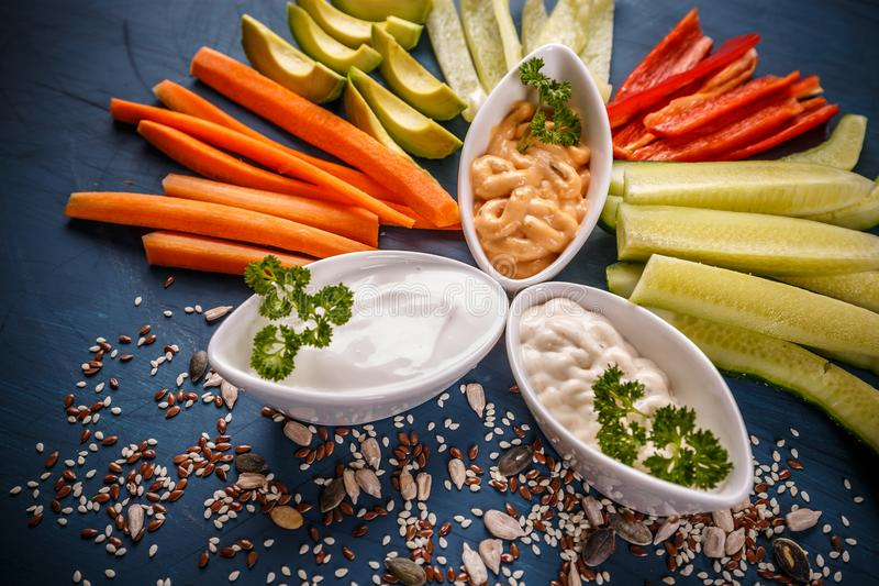 Colorful slices of raw vegetables royalty free stock image