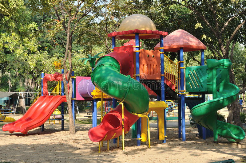 Colorful Sliders In Public Playground In Garden. Royalty Free Stock Photography