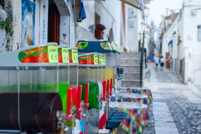 Colorful slushes on display in the historical center of an italian sea town stock image