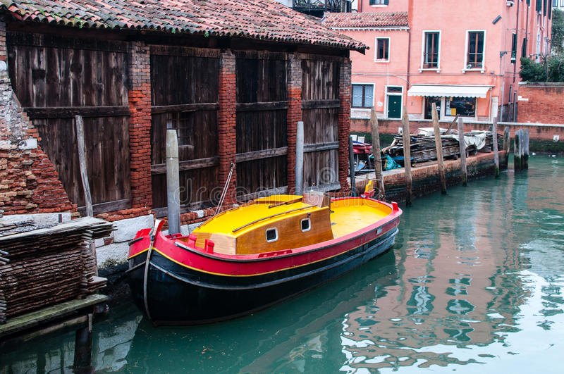 Colorful small boats for transport in a canal of Venice. Near Squero San Trovaso, the Gondolas factory stock photos