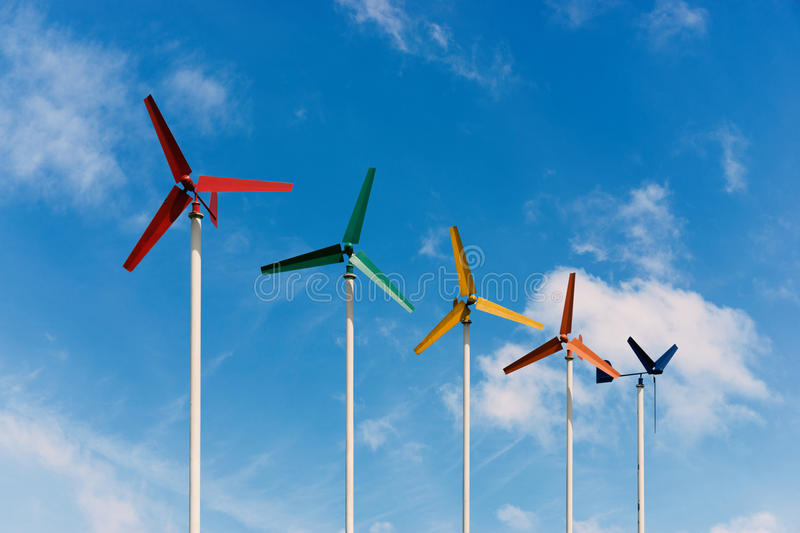 Colorful small wind turbine stand out the sky stock photos