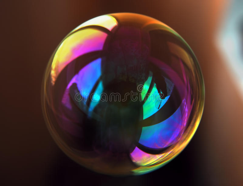 Colorful soap bubble with clear reflection on it. The Colorful soap bubble with clear reflection on it royalty free stock photography