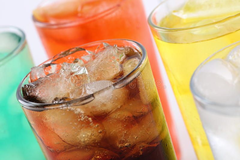 Colorful soda drinks with cola stock image
