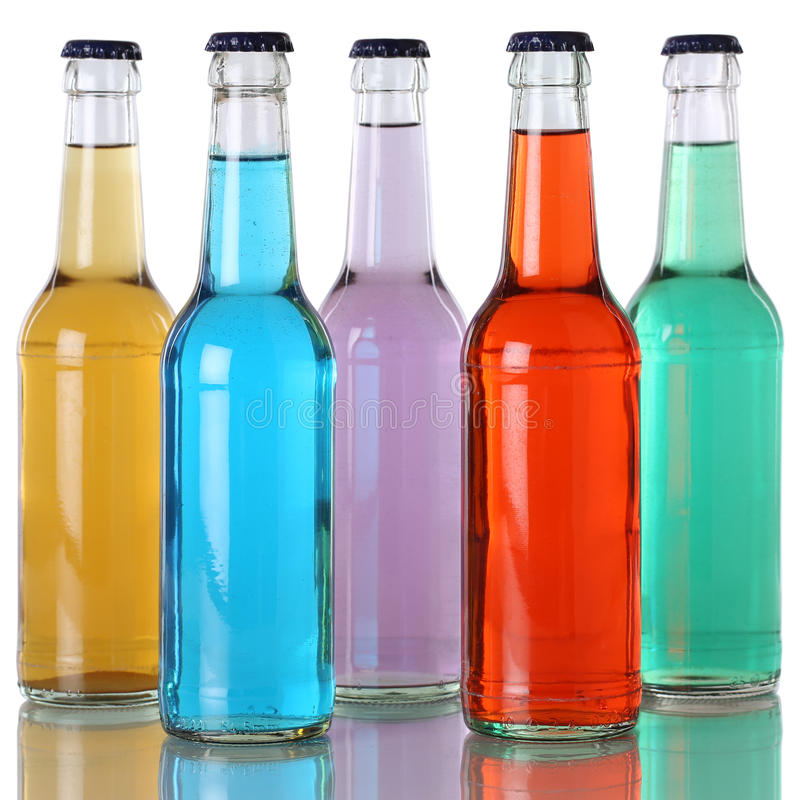Colorful soda and soft drinks in bottles with reflection. Colorful soda drinks, lemonades and soft drinks in bottles with reflection stock photos