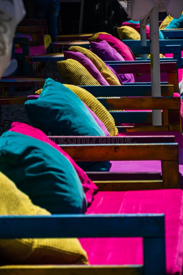 Colorful sofas in front of pubs in Oldtown Bucharest.  stock image