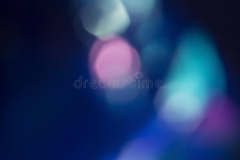Colorful soft circular bokeh overlay. For use to enhance images with copy space on a deep twilight blue background royalty free stock images