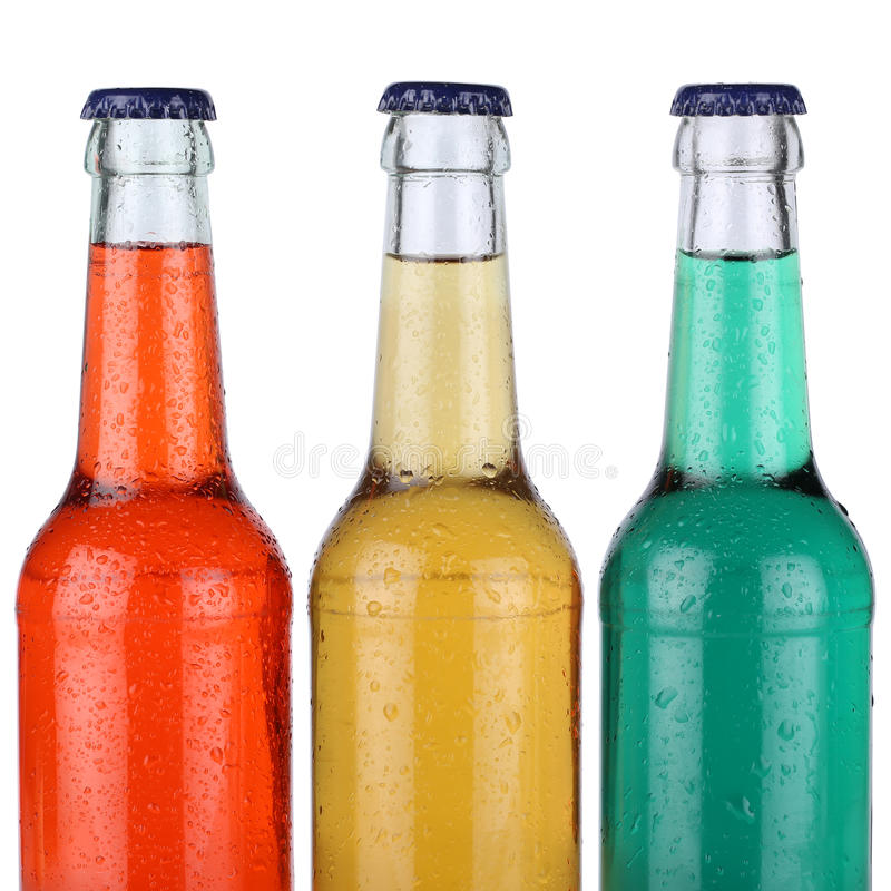 Colorful soft drinks or lemonade in bottles isolated stock images