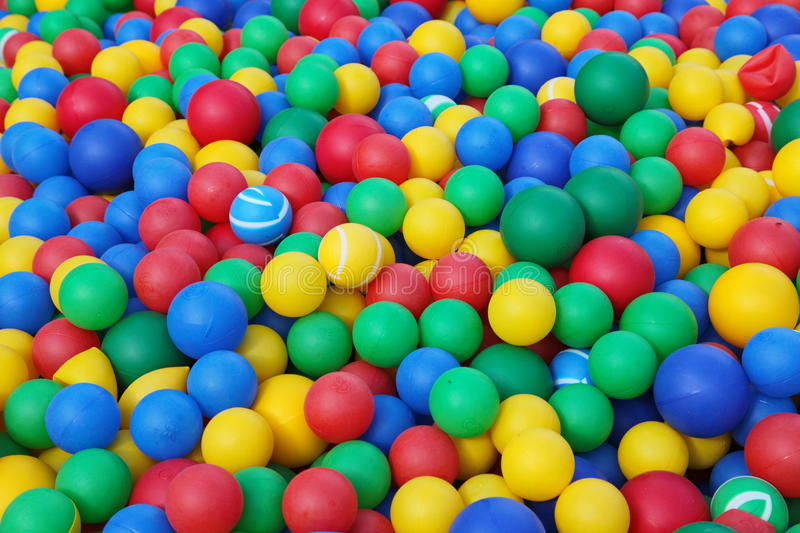 Colorful soft rubber balls ( balls ) for the children's dry pool. Colorful balls in playground. Soft and flexible many balls for childs play in playground. Good stock photography
