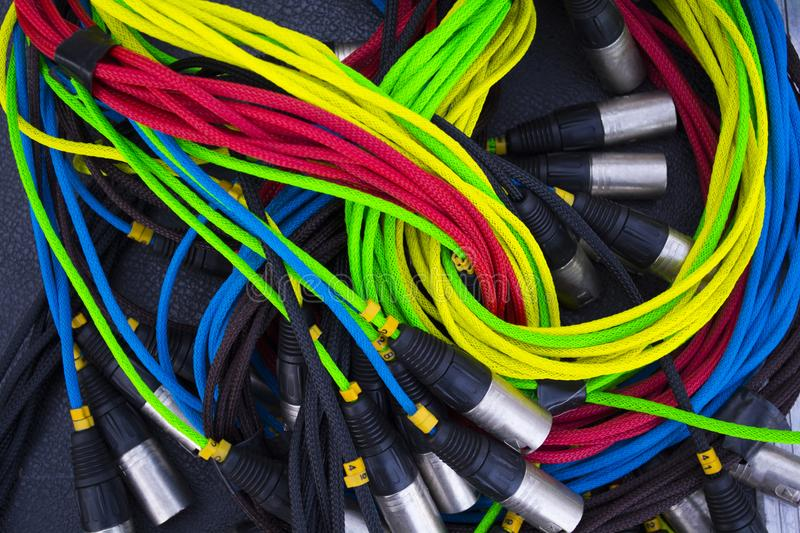 Colorful sound and light signal cables on black stage case, shallow focus stock photo