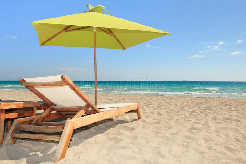 Colorful South Beach Umbrella and Lounge Chair royalty free stock photos