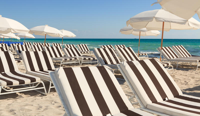Colorful South Beach Umbrellas and Lounge Chairs stock photos