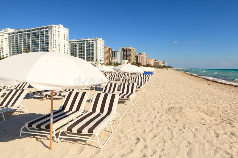 Colorful South Beach Umbrellas and Lounge Chairs stock images