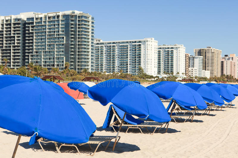 Colorful South Beach Umbrellas and Lounge Chairs royalty free stock photos