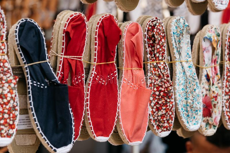 Colorful handmade rope soled sandals or espadrilles in market st. Colorful spanish handmade rope soled sandals or espadrilles in market stall royalty free stock photo