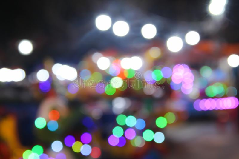 Colorful  sparkle bokeh  night traffic from light bulb ,motorcycle and car background royalty free stock image