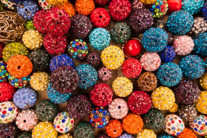 Colorful sparkling balls of jewelery beads display stock photography
