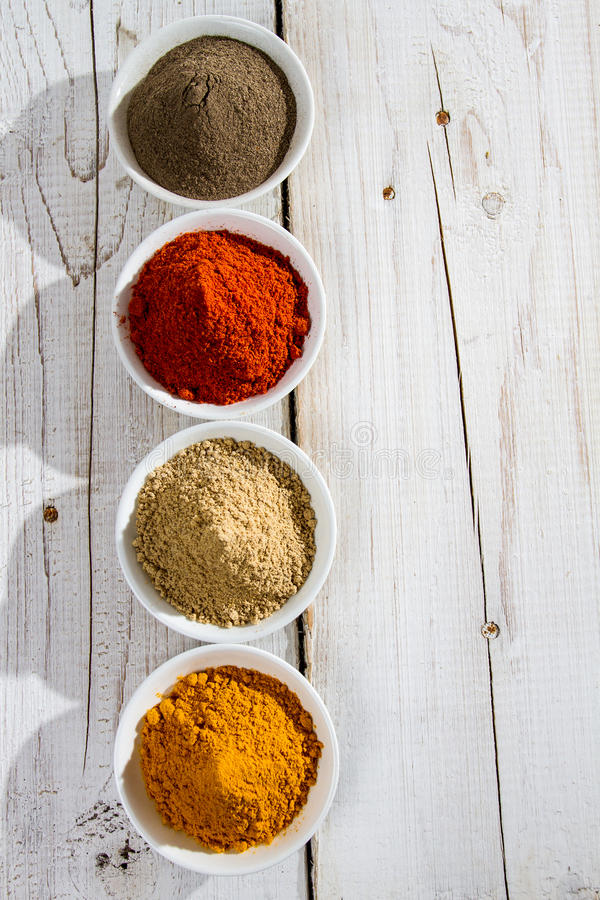 Colorful spices in small bowl royalty free stock photos