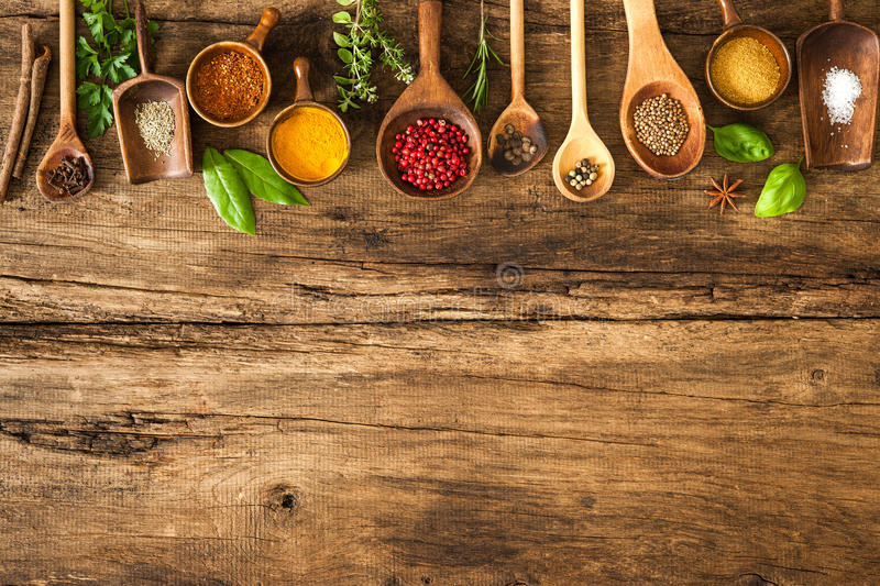 Colorful spices on wooden table royalty free stock photo