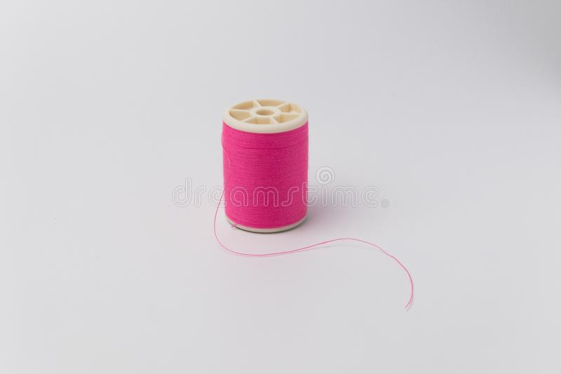 Colorful Spool of thread isolate on white background. royalty free stock photography