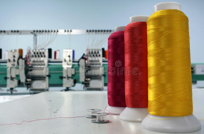 Colorful spools embroidery thread production royalty free stock photos