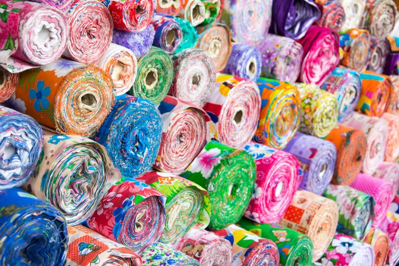 Colorful spools of textiles stock images