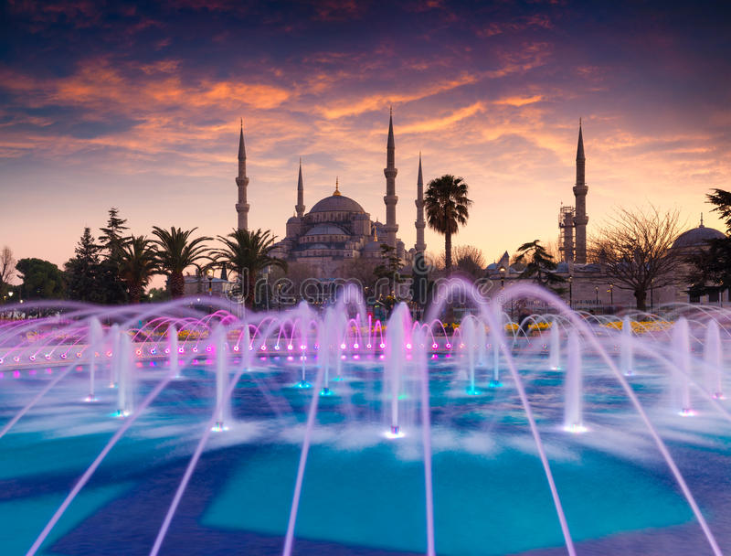 Colorful spring sunset in Sultan Ahmet park in Istanbul, Turkey, Europe. Colorful fountain on the background of the Loonic Blue M stock image