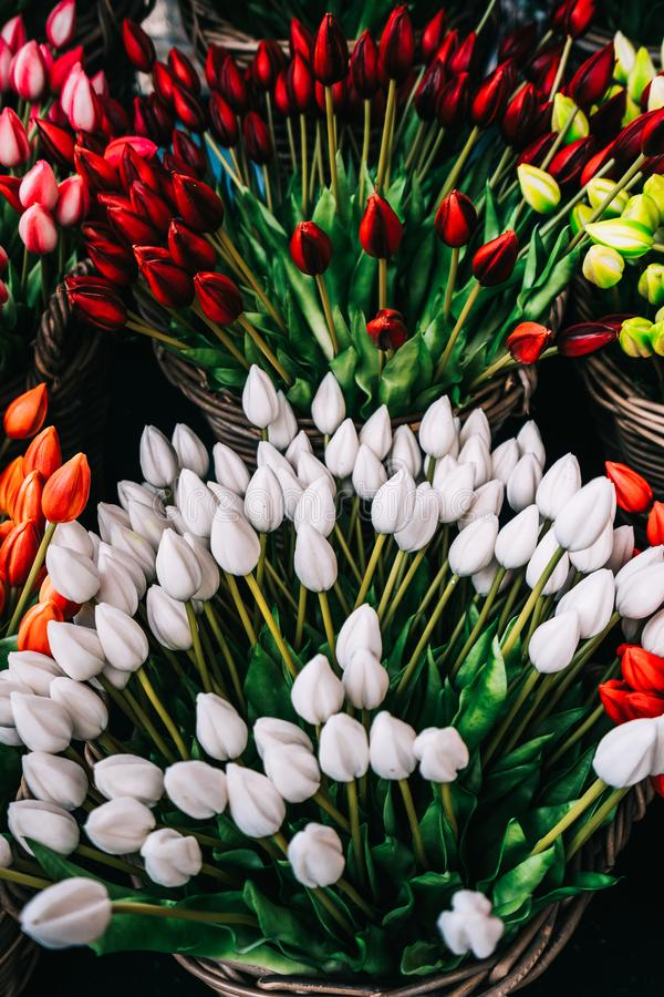 Colorful spring tulips flowers in wicker baskets stock images