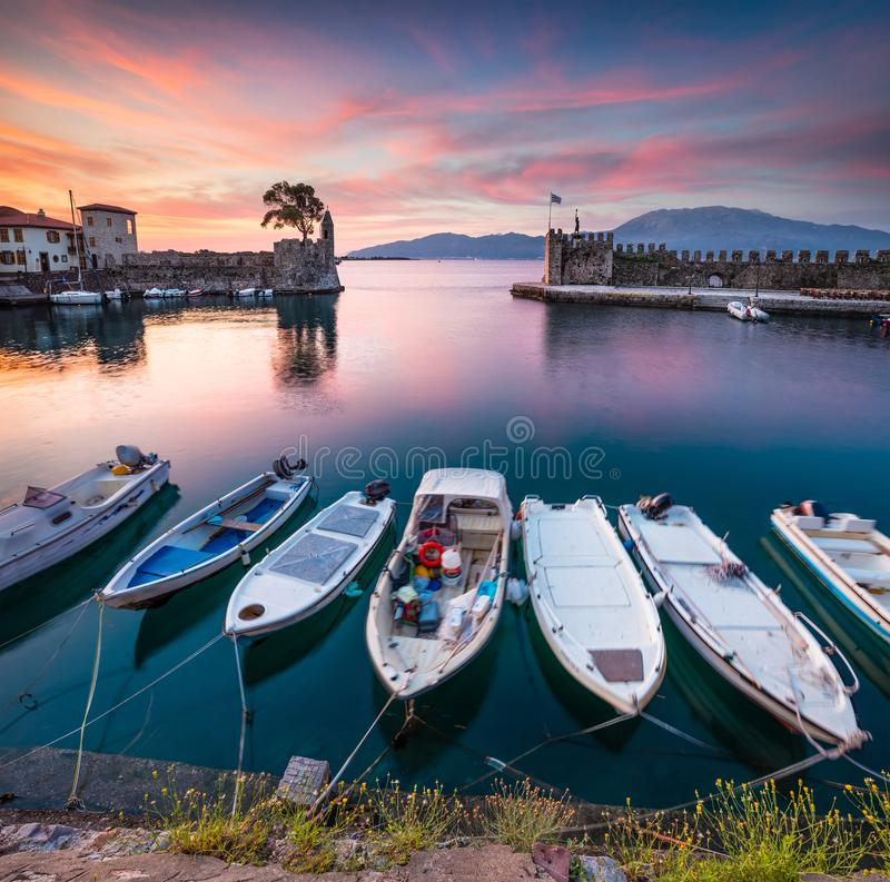 Colorful spring view of the Nafpaktos port. Fantastic sunrise in the Gulf of Corinth, Greece, Europe. Beauty of countryside. Concept background. Beauty of stock images