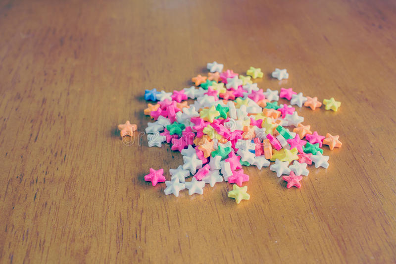 Colorful sprinkles. Colorful star-shaped sprinkles in retro filter stock image