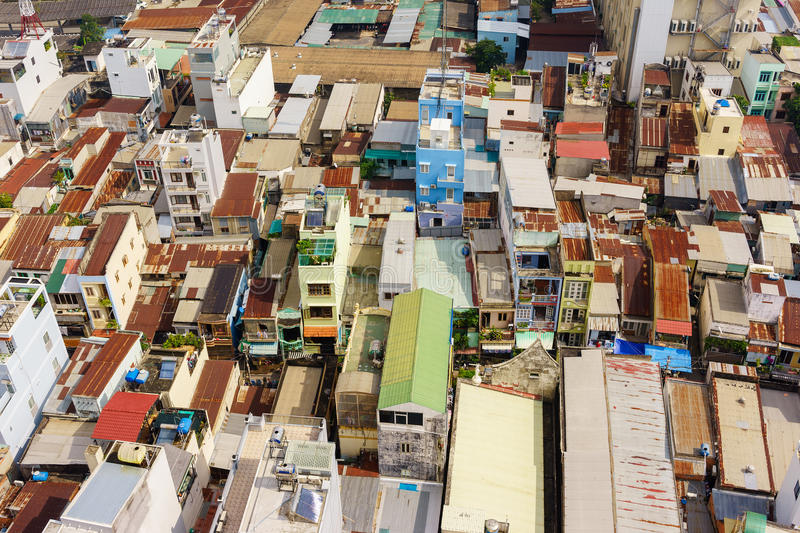 Colorful squatter shacks and houses in a Slum Urban Area in Saigon, Vietnam. stock photos