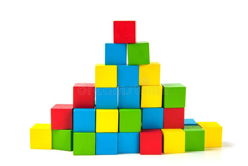 Colorful stack of wood cube building blocks on white background royalty free stock photos