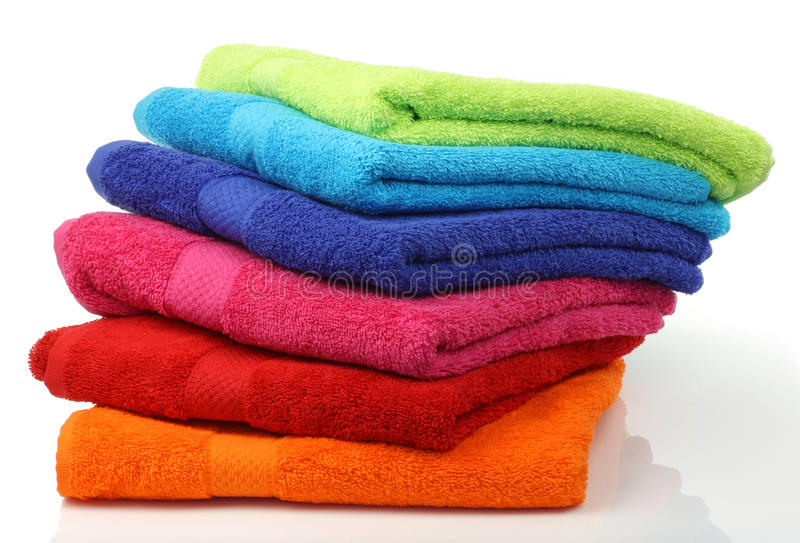 Colorful stacked bathroom towels. On a white background stock photo
