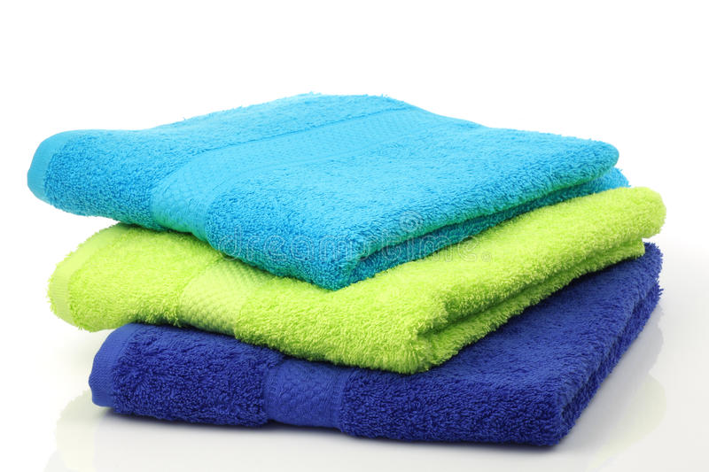 Colorful stacked bathroom towels. On a white background stock photos