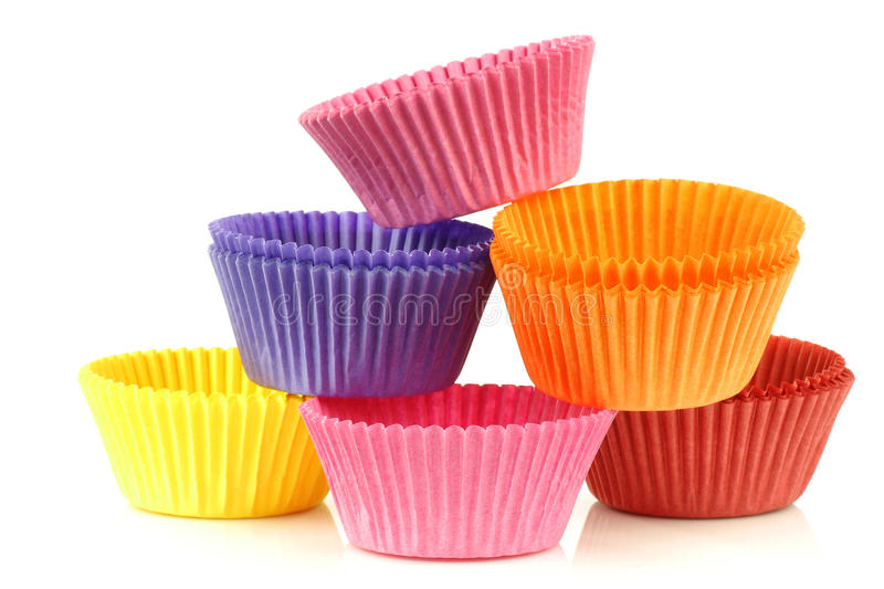 Colorful stacked empty muffin cups royalty free stock images