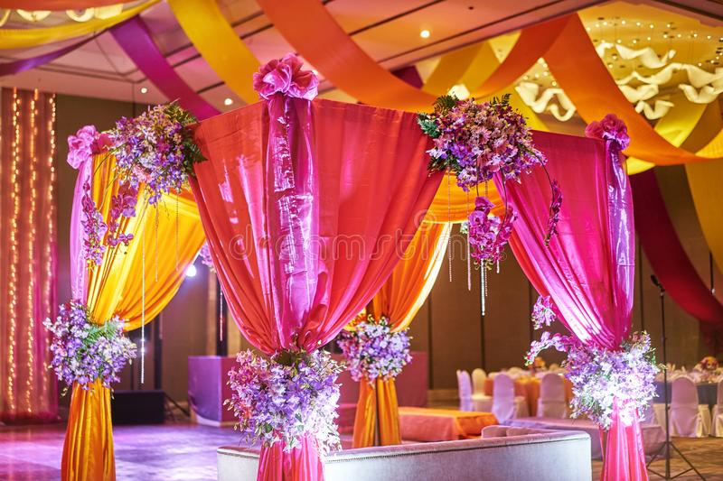 Colorful stage decoration for bride and groom in sangeet night of indian wedding stock image