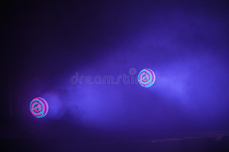 Colorful stage LED spot lights. With blue beam, stage illumination equipment royalty free stock photo