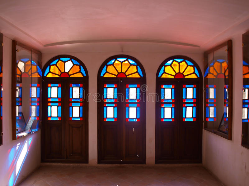 The colorful stained glass decoration in historical house in Kashan, Iran royalty free stock photo