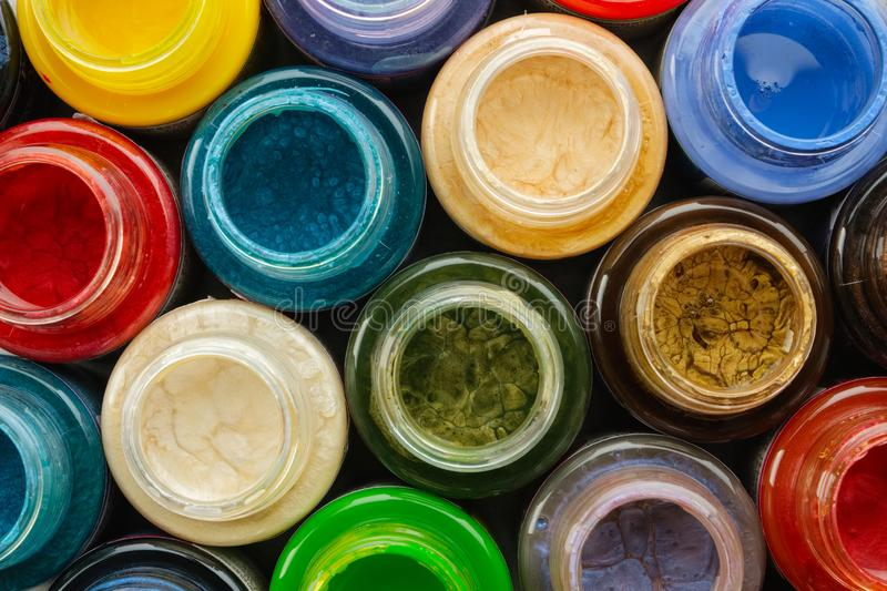Colorful stained glass paints or oil, acrylic paints close up. Colorful stained glass paints or oil, acrylic paints close up, top view stock photo