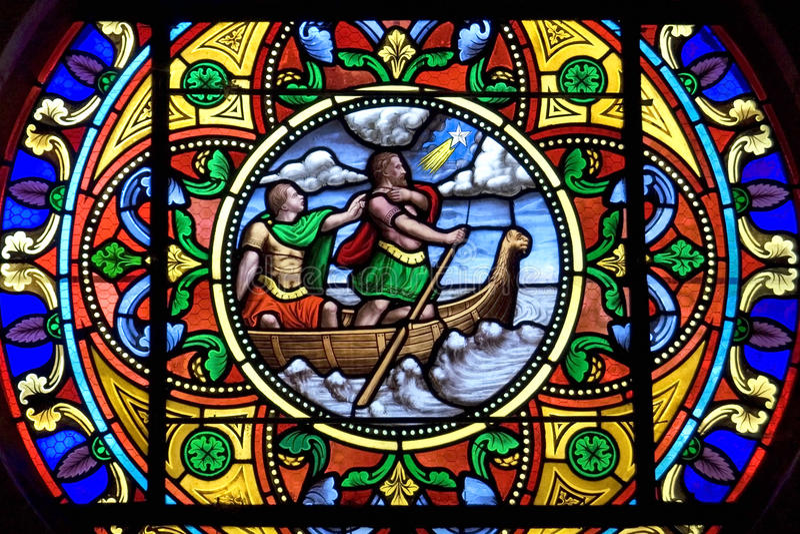 Colorful stained-glass window, Charite-sur-Loire. France, department Nievre, region Burgundy, district Cosne-Cours-sur-Loire; town, small city Charite-sur-Loire stock images