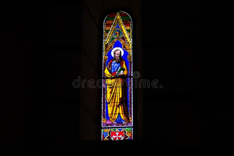 Pisa, Italy - May 24, 2018: colorful stained glass window inside Pisa Baptistery of St. John Battistero di San Giovanni at. Colorful stained glass window inside stock image